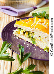 large piece of the pie with spring onions and eggs