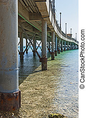 Large pier jetty on a tropical beach resort