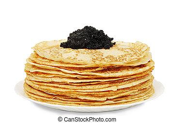 large pile of ruddy pancakes with caviar