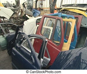 Large piles of hoods, bumpers, door