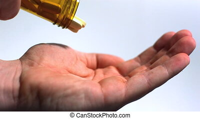 Large pills being poured into hand