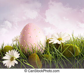 Large pink easter with flowers in tall grass with sky