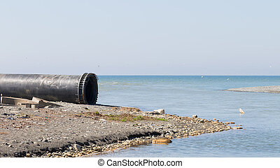 large pipe by the sea