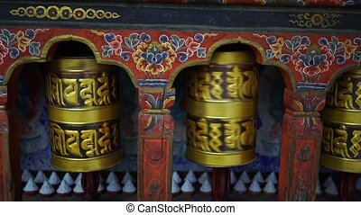 large prayer wheel in buddhist temple at Namobuddha Concept of hope and meditation