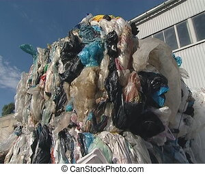 Large pressed polythene heaps prepared for recycling....
