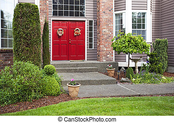 Large red door with grand entrance in a big house
