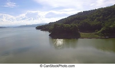 Large reservoirs of water hydro electric dam submerging part...