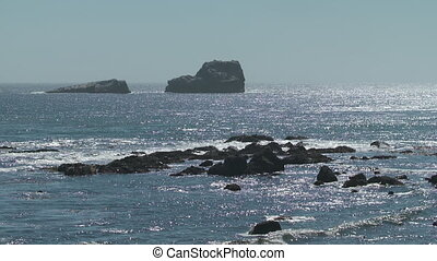Large Rocks and Boulder In Ocean - Steady, medium wide shot...