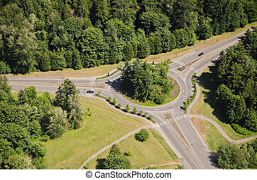 Large Roundabout - Aerial - Two cars approach roundabout...