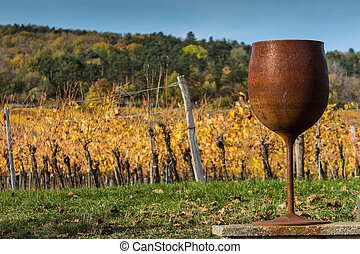 large rusty glas made of steel in vineyards in autumn