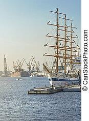Large sailing ship in city port at berth