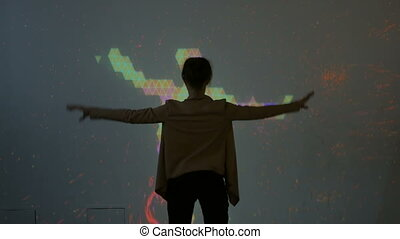 Large screen augmented reality experience - woman waving her...