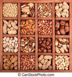 Large selection of peeled nuts, and kernels in shell, in wooden box with cells
