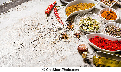 Large set of spices and herbs in the cups.