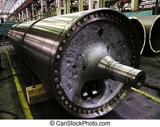 large shaft in the shop engineering plant - large metal...