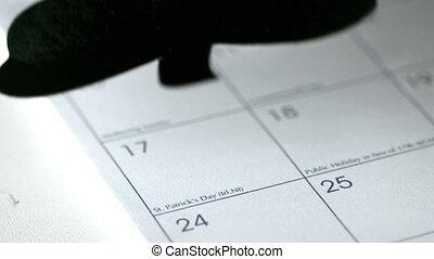 Large shamrock falling on calendar
