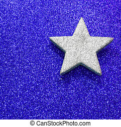 large silver star on blue bright background