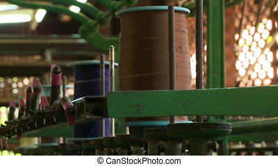 Large spool of brown thread at the silk factory - An...