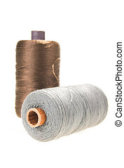 large spools of thread on a white background