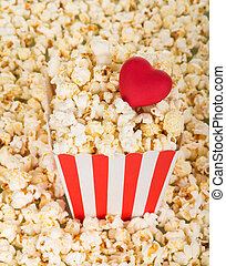 Large square box of popcorn and red heart, ot popcorn...