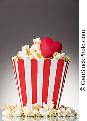 Large square box popcorn and red heart, lot popcorn around...