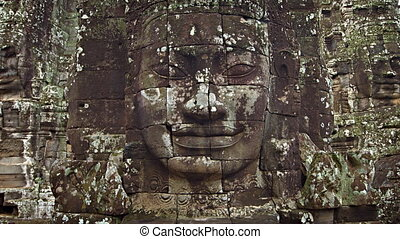 Large stone faces on the towers at The Bayon temple....
