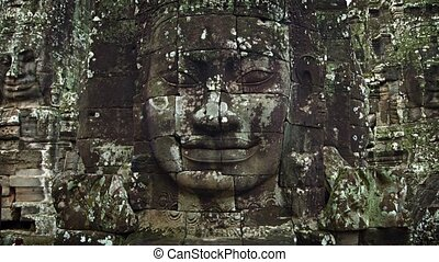 Large stone faces on the towers at The Bayon temple. Cambodia. UltraHD 2160p 4k video