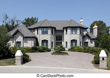 Large stone home with pillars