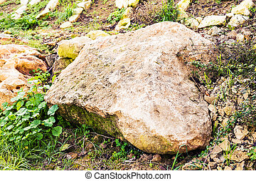 Large stone in a green grass are a confidence and tranquillity symbol