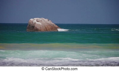 large stone in the sea bay