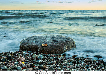 Large stone on the Baltic coast with stony coastline
