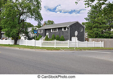 Large Suburban Home with White Picket Fence Corner Lot