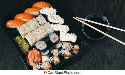 Large sushi sets with lots of sushi, roll, maki, nigiri,...