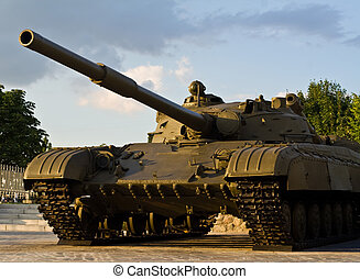 large tank on a background cloudy sky