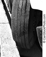 Large Tire Against Curb