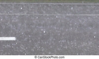 Large torrential rain. The surface of the road boils from large drops. Super slow motion 1000 fps
