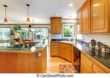 Large traditional wood golden kitchen.