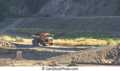 large truck hauls dirt