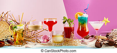 Large variety of exotic summer cocktails on sand