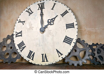 Large vintage clock and gears around wall