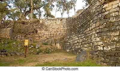 large wall built along hillside on Machu Picchu - view of...