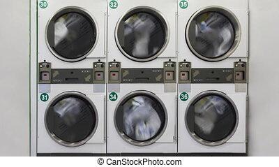 Large washing machines in public laundry room - six large...