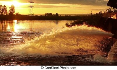 Large water pipe discharging liquid waste into river