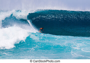 Large Wave Surfing - A surfer gets out in front of an...