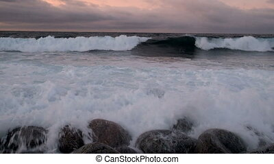 Large waves beating against the rocks in the North Sea.