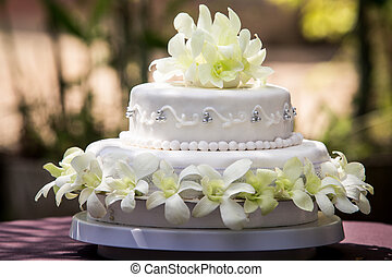large wedding cake with white orchids and pearls