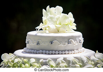 large wedding cake with white orchids