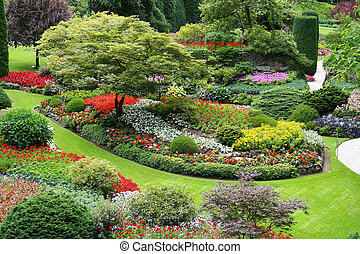 Large well groomed Flower garden with walkling paths.