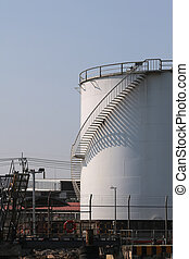 large white Industrial tanks for petrol and oil ,shadows of the stairs.