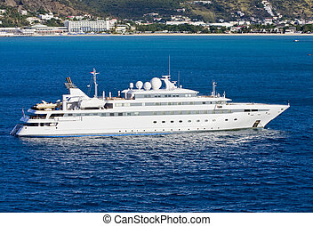Large White Yacht in Blue Bay